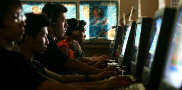 Chinese youths use computers at an Internet cafe in Beijing (AP Photo/Greg Baker, File).
