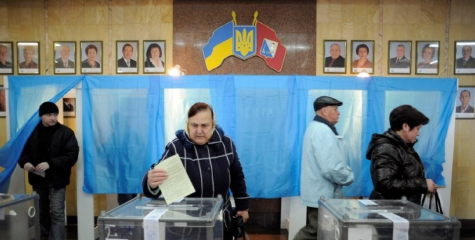 A woman casts her ballot at a polling station during the Crimean referendum, in Sevastopol, Ukraine, Sunday, March 16, 2014. Residents of Ukraine's Crimea region are voting in a contentious referendum on whether to split off and seek annexation by Russia. (AP Photo/Andrew Lubimov)
