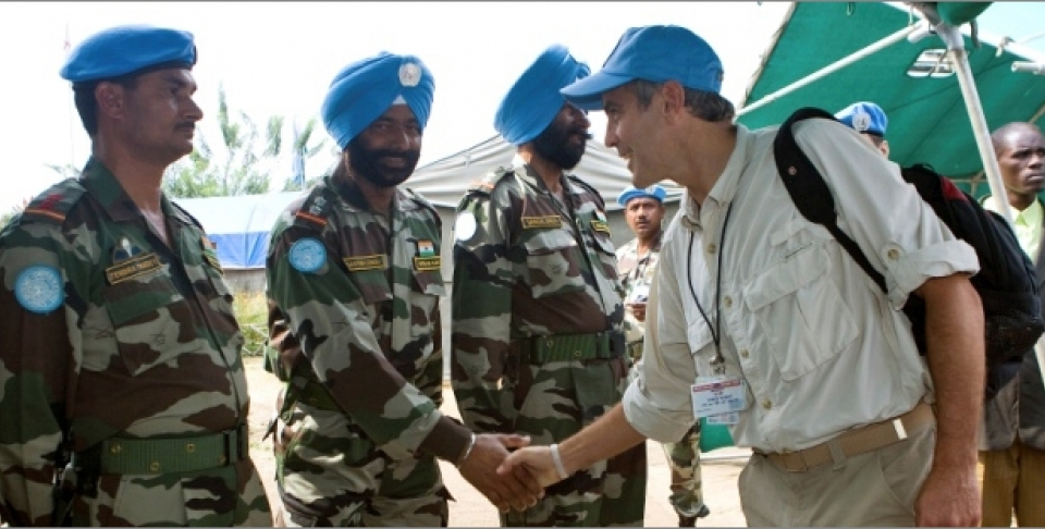 January 2008, George Clooney, appointed UN Messenger for Peace, shakes hands with a member of the Indian Battalion of the United Nations Organization Mission in the Democratic Republic of the Congo, during his tour of the UN Peacekeeping Missions in Africa. (UN Photo/Marie Frechon)