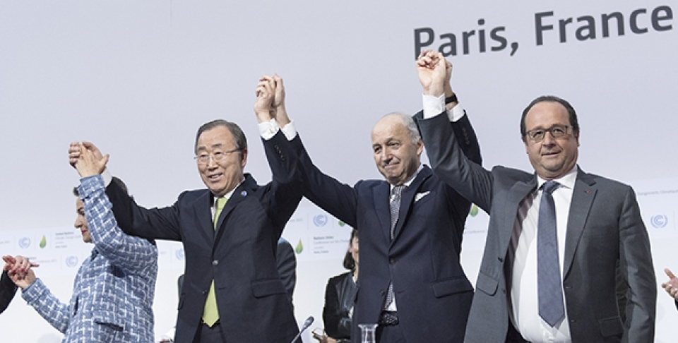 UN Secretary-General Ban Ki-moon, Christiana Figueres, Executive Secretary of the UNFCCC, Laurent Fabius, Minister for Foreign Affairs of France and President of COP21, and François Hollande, President of France celebrate after the historic adoption of Paris Agreement on climate change. (UN Photo/ Mark Garten)