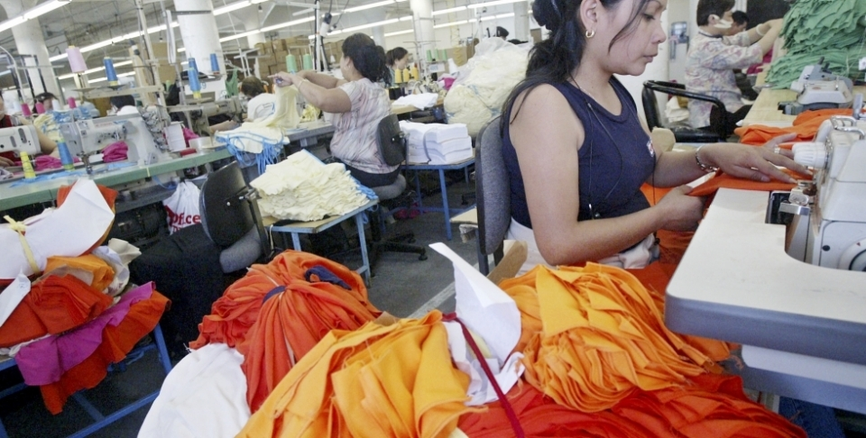 Workers sew at an American Apparel factory in Los Angeles. In an industry with a history of sweatshops, American Apparel is one of two Los Angeles firms convinced it can make money without underpaying or overworking employees. (AP Photo/Ric Francis)
