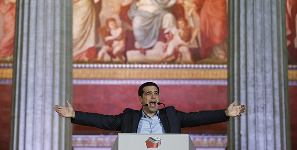 In this photo taken in January 2015, leader of SYRIZA left-wing party Alexis Tsipras speaks to his supporters after his election victory outside Athens University Headquarters. (AP Photo/Petros Giannakouris)