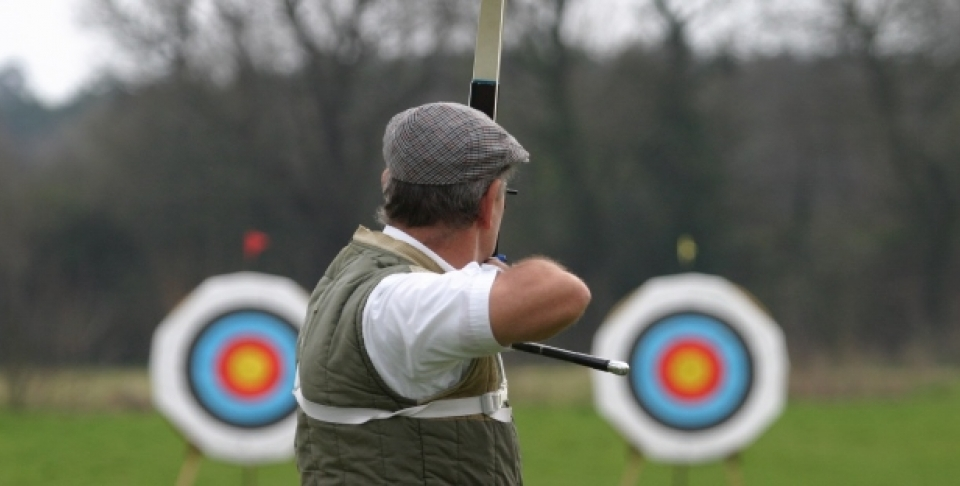 A sports archer aims at targets. (Shutterstock)