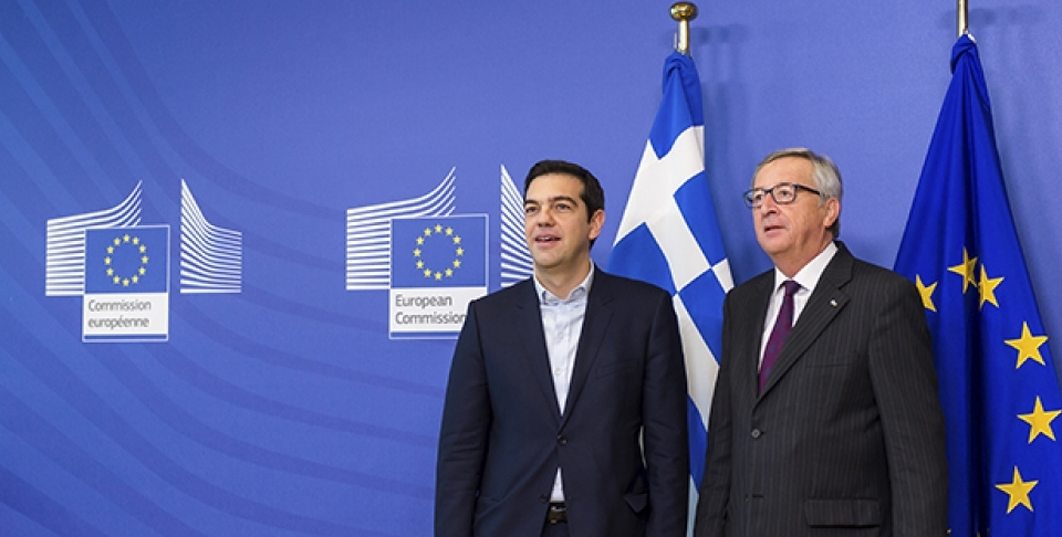 European Commission President Jean-Claude Juncker, right, stands with Greece's Prime Minister Alexis Tsipras upon his arrival at the European Commission headquarters in Brussels Wednesday, Feb. 4, 2015. (AP Photo/Geert Vanden Wijngaert)