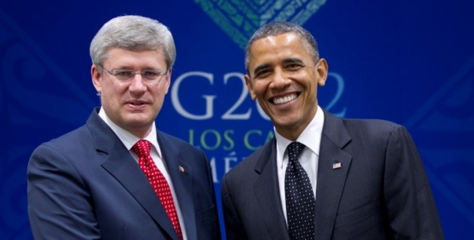 Prime Minister Stephen Harper poses with Barack Obama, President of the United States, after it was announced that Canada would join the Trans-Pacific Partnership. (AP Photo/Carolyn Kaster)