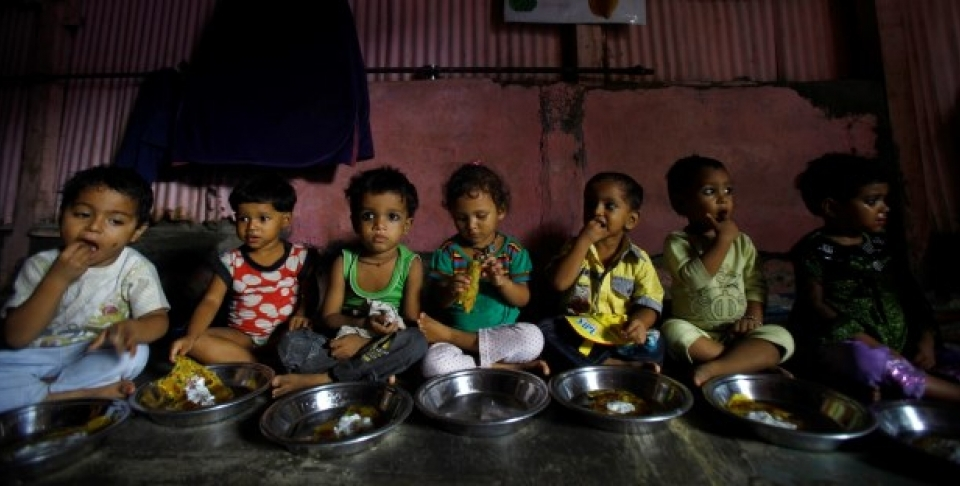 Malnourished Indian children eat a meal at the Apanalaya center, an organization working for the betterment of slum children, in Mumbai,India. (AP Photo/Rafiq Maqbool)