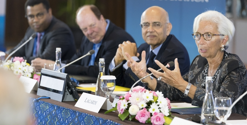 International Monetary Fund Managing Director Christine Lagarde speaks at the Bretton Woods Committee on October 10, 2018 in Bali, Indonesia. Masood Ahmed, president of Center for Global Development and Thomas Bernes, a distinguished fellow at CIGI sit to her left. (IMF Staff Photo/Stephen Jaffe)