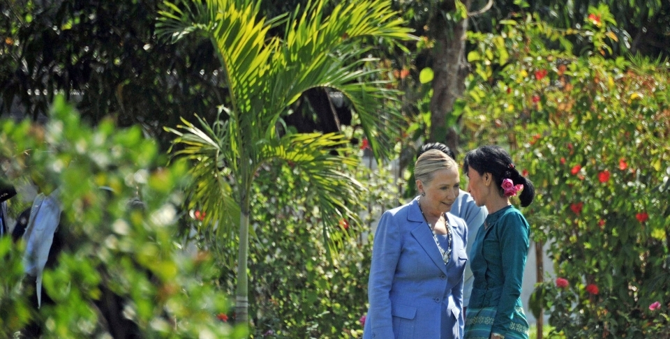 Aung San Suu Kyi, right, talks with visiting U.S. Secretary of State Hillary Clinton at a private residence in Yangon, Myanmar in 2011. (AP Photo/Soe Than Win, Pool)