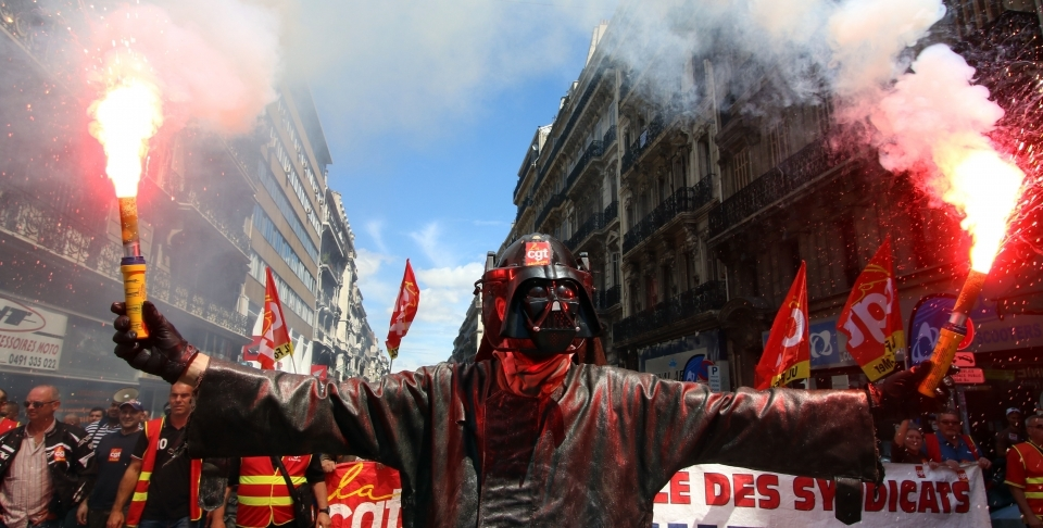 A steelworker in France protests labour reforms