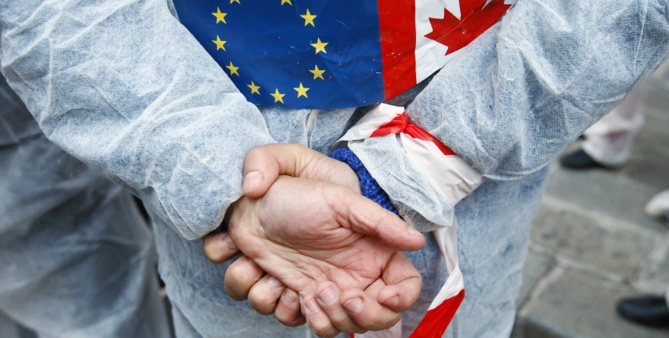 An activist protests the EU trade deal with Canada (AP Photo/Francois Mori)