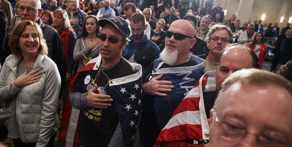 Supporters say the pledge of allegiance during a campaign rally (AP Photo/ Evan Vucci)