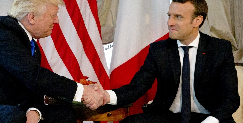 US President Donald Trump shakes hands with French President Emmanuel Macron (AP Photo/Peter Dejong, Pool)