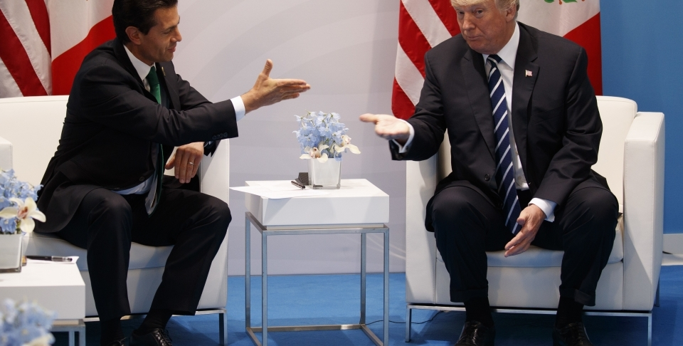 US President Donald Trump meets with Mexican President Enrique Pena Nieto at the G20 Summit, in Hamburg, July 7, 2017 (AP Photo/Evan Vucci, File)