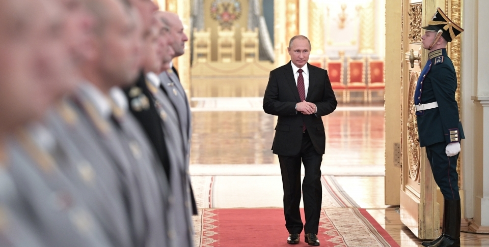 Russian President Vladimir Putin walks in a hall during a meeting with senior military officers in the Kremlin. (Alexei Nikolsky, Kremlin Pool Photo via AP)