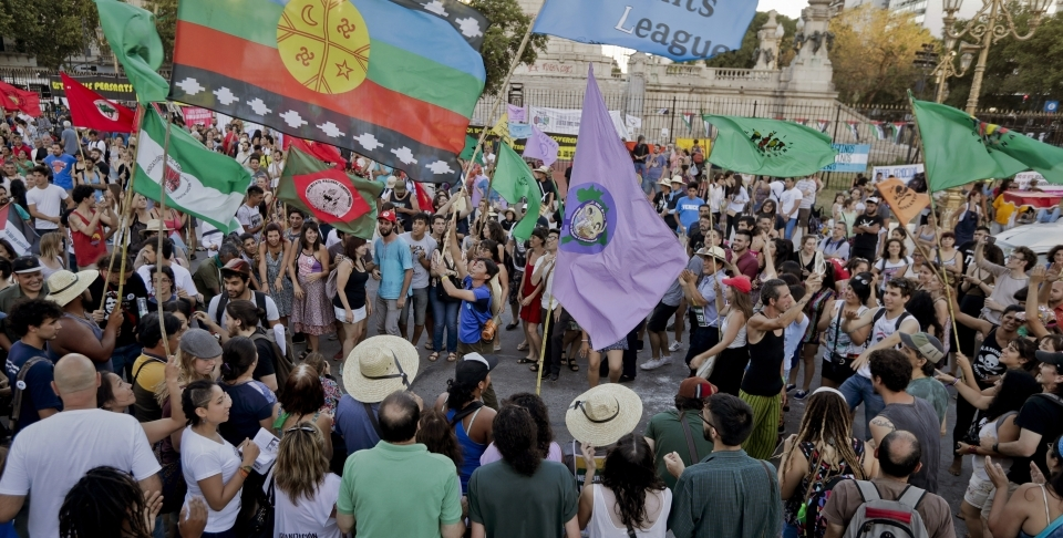 Activists from grassroots organizations chant slogans against free trade and the World Trade Organization conference, in Buenos Aires, Argentina. (AP Photo/Victor R. Caivano)