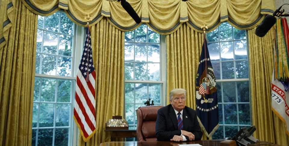 President Donald Trump listens during a phone call with Mexican President Enrique Pena Nieto about a trade agreement between the United States and Mexico on August 27, 2018. (AP Photo/Evan Vucci)