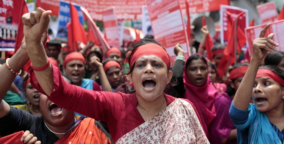 Garment workers and activists shout slogans during a May Day rally in Dhaka, Bangladesh. (AP Photo/A.M. Ahad)