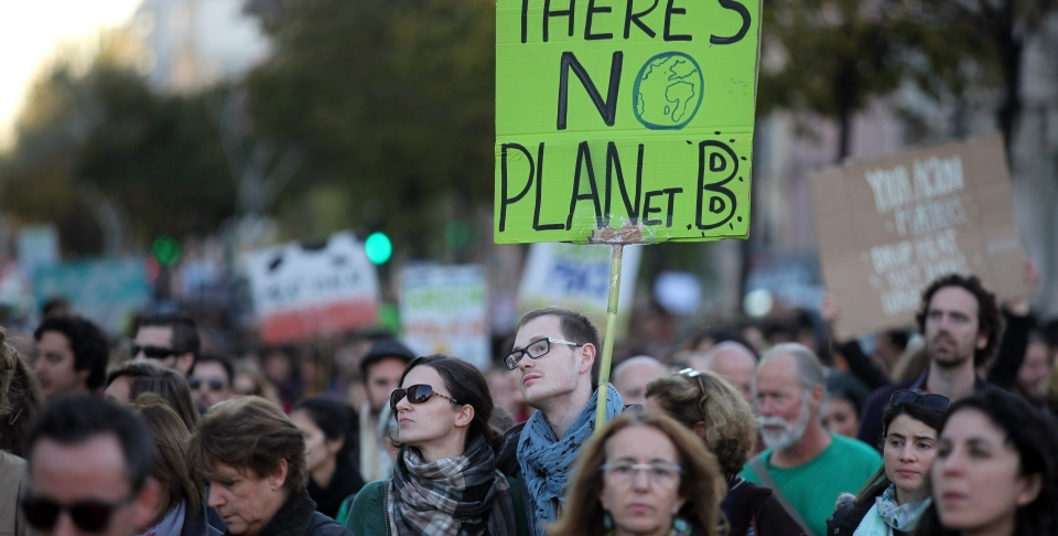 Rallies were organized around the world on Sunday, calling on all government leaders to halt climate change on the eve of a major conference in Paris. (AP Photo/Armando Franca)