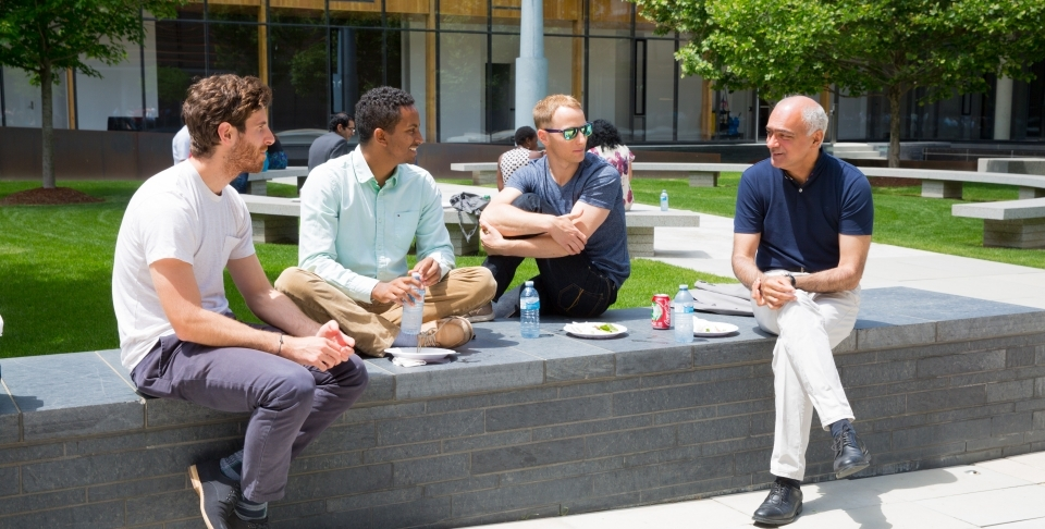 CIGI President Rohinton Medhora and staff enjoy a beautiful day in the CIGI campus courtyard over lunch.