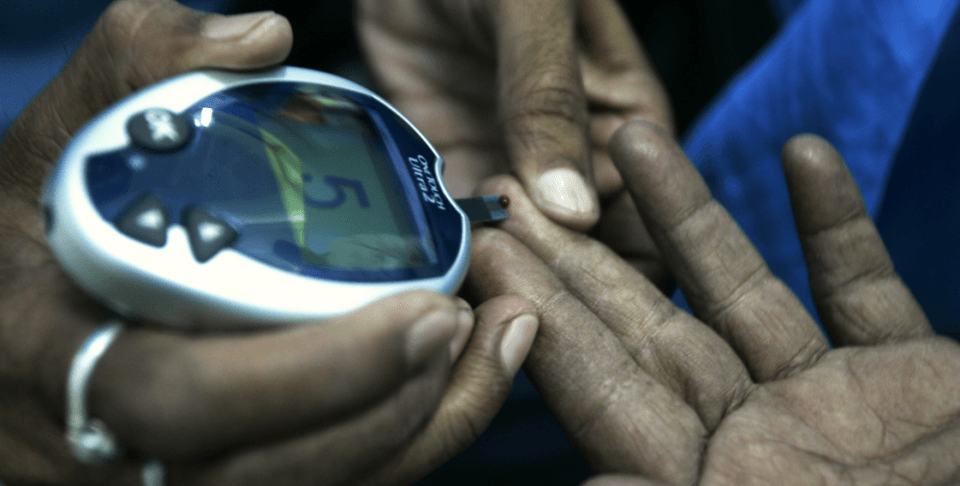 A health worker takes a blood sample from a diabetic patient (AP Photo/Bikas Das)