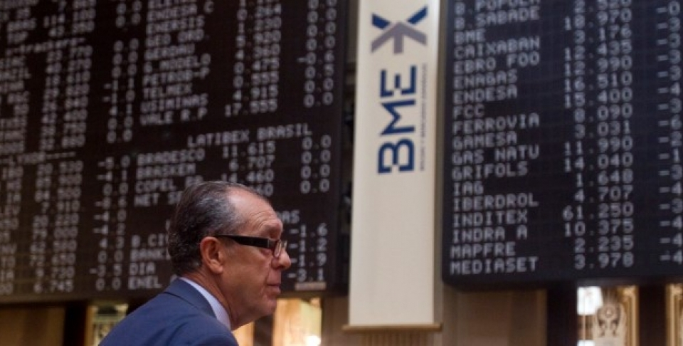 A broker looks on in front of a screen at the Stock Exchange in Madrid. (AP Photo/Paul White)
