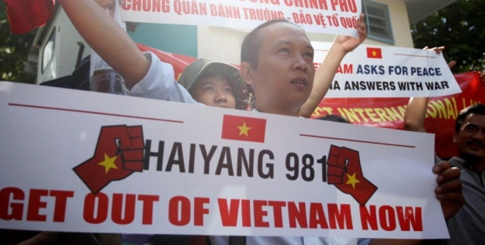 Vietnamese protesters hold banners during a protest rally against China outside the Chinese Consulate in Ho Chi Minh City, Vietnam, Saturday, May 10, 2014.  (AP Photo)