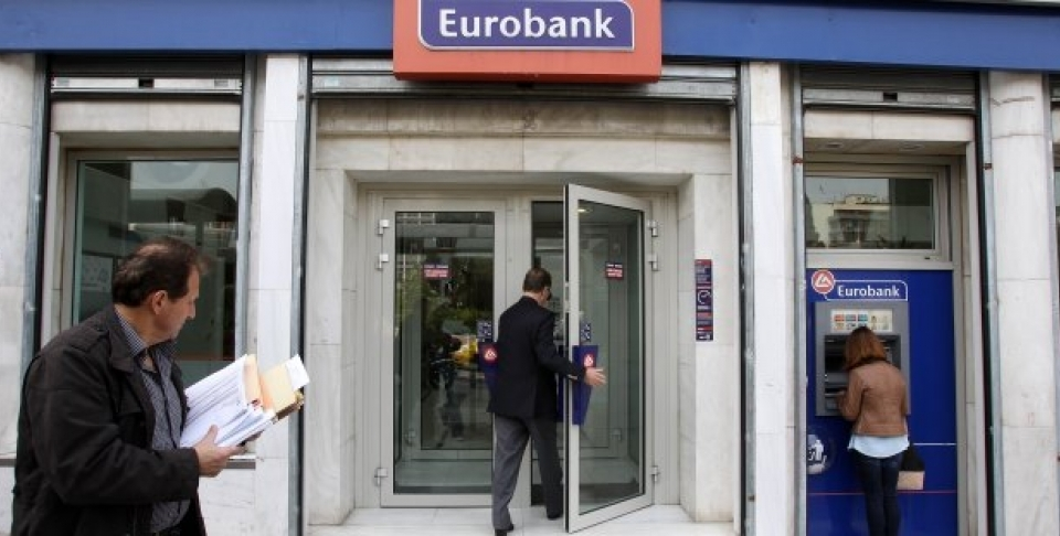 Customers use the ATM and enter a branch of Eurobank in central Athens. (AP Photo/Thanassis Stavrakis)