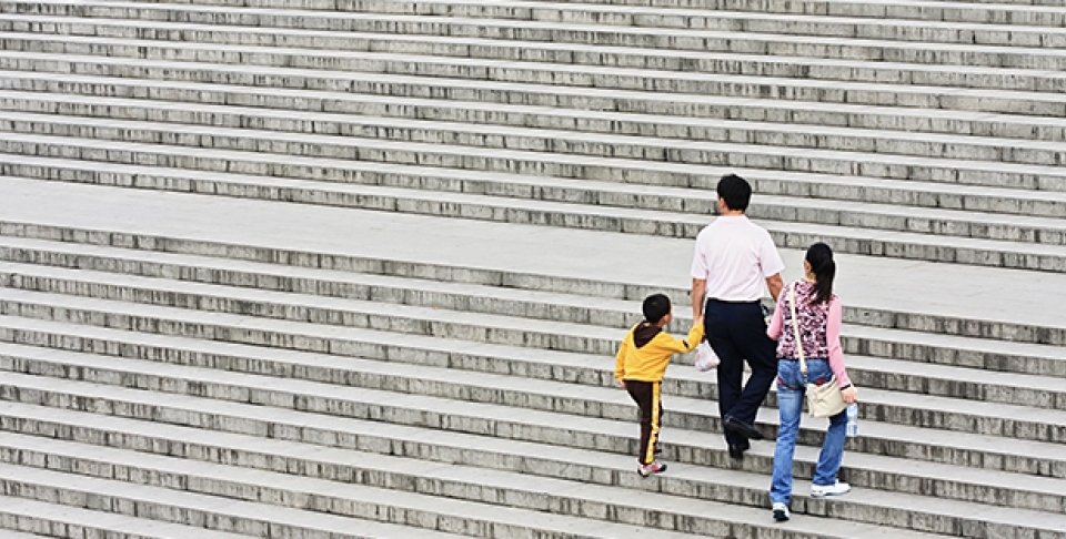 A family's way up on a staircase in May 2009 in Xian, China. (Shutterstock Image)