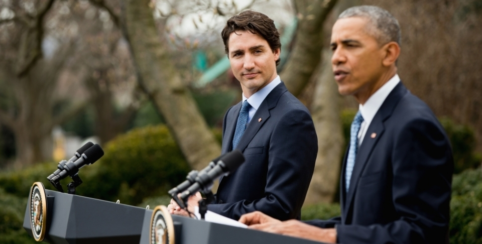 Canadian Prime Minister Justin Trudeau listens as President Barack Obama speaks during a bilateral news conference in the Rose Garden of the White House in Washington, March 10, 2016. (AP Photo/Andrew Harnik)