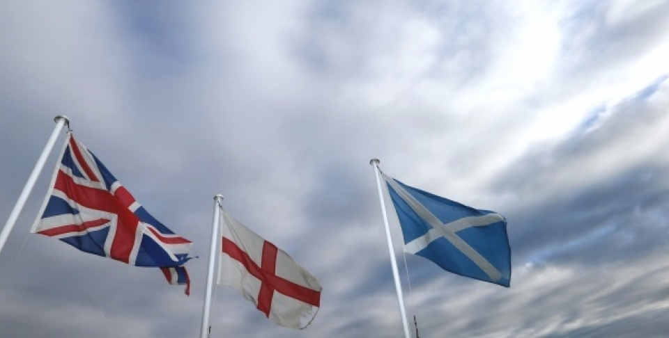 From left, the Union Jack, St George's Cross and the Saltire fly at Adderstone, England, Monday, Sept. 8, 2014.