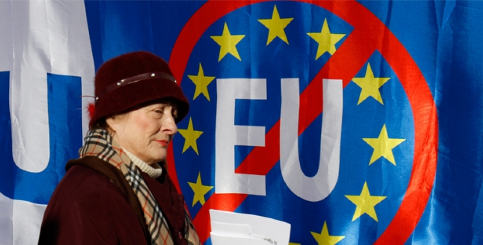 A woman walks past anti-EU banners during a protest in Zagreb, Croatia. Croatia signed an EU accession treaty in 2011 and is set to become a member in July 2013 (AP Photo/Filip Horvat).