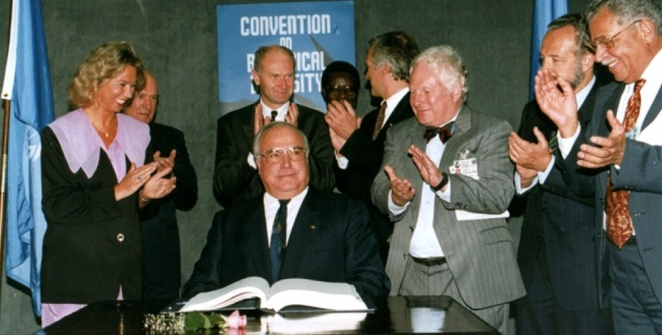 German Chancellor Helmut Kohl acknowledges the applause by a group of unidentified official observers after he has signed the biodiversity treaty at the Earth Summit in Rio de Janeiro. (AP Photo/Ricardo Mazalan/1992)