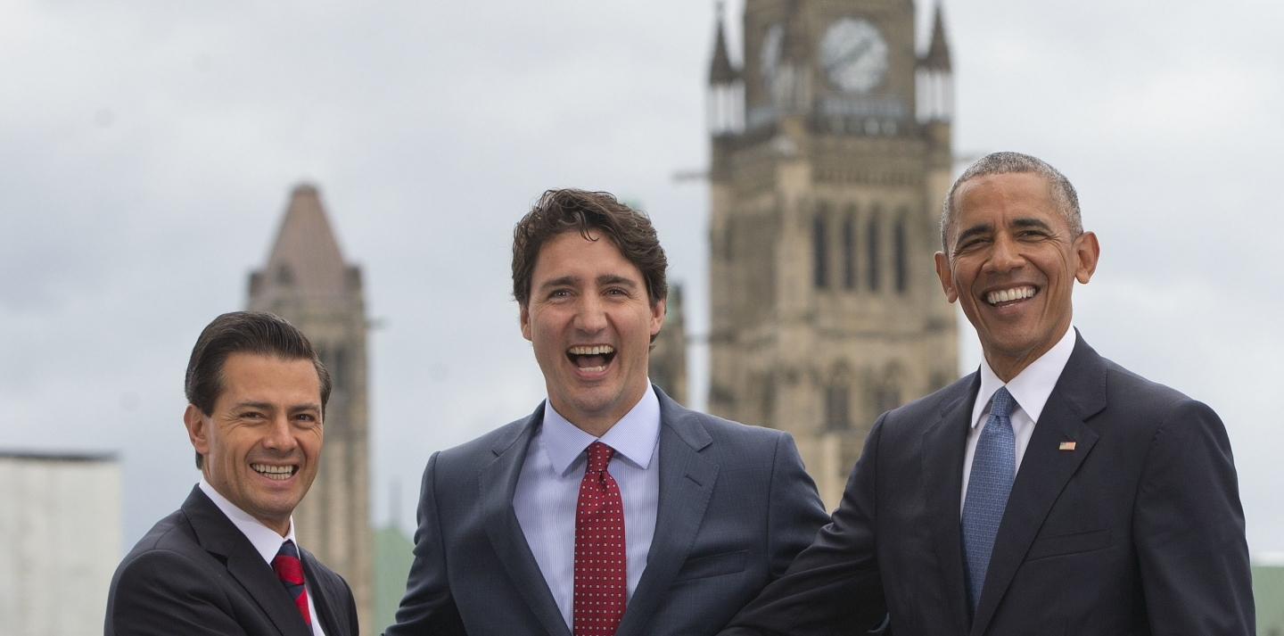 US President Barack Obama, Canadian Prime Minister Justin Trudeau and Mexican President Enrique Pena Neito in front of Parliament Hill on Wednesday, June 29, 2016. (AP Photo/Pablo Martinez Monsivais)
