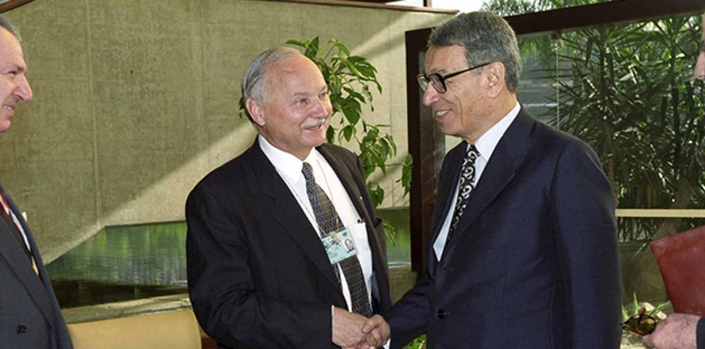 UN Secretary-General Boutros Boutros-Ghali is greeted by Maurice Strong, Secretary-General of the United Nations Conference on Environment and Development (UNCED), upon his arrival at Rio Centro for the first day of the Conference, on June 3, 1992 in Rio de Janeiro, Brazil. (UN Photo/Michos Tzovaras)