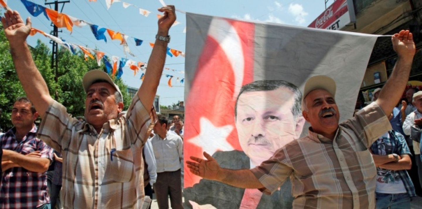 Turks celebrate the re-election of Prime Minister Recep Tayyip Erdogan in June 2011. (AP Photo/Burhan Ozbilici)