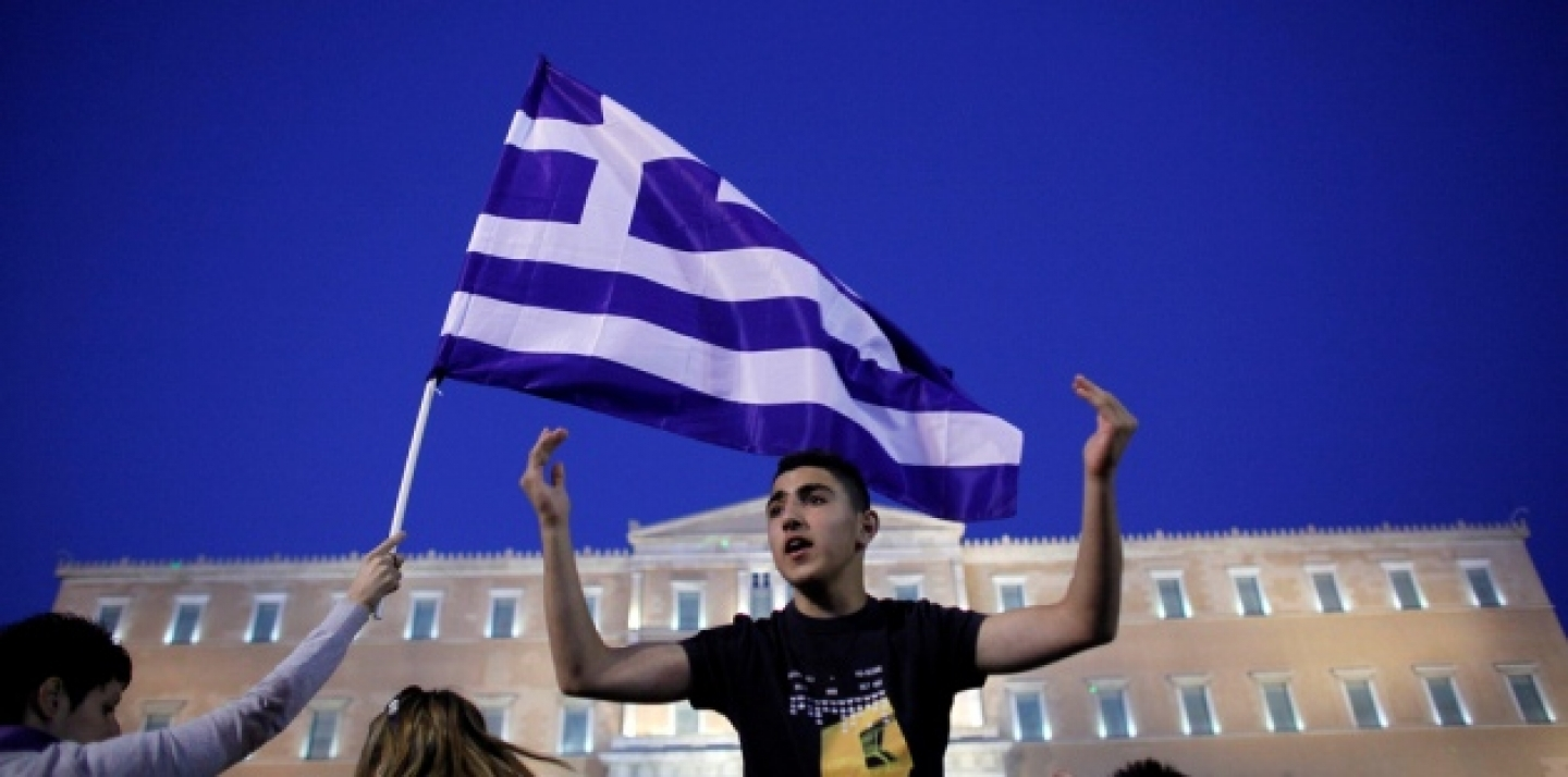 A young protester shouts slogans in front of the Greek parliament during a protest against austerity measures in Athens in June, 2011. (AP Photo/Kostas Tsironis)