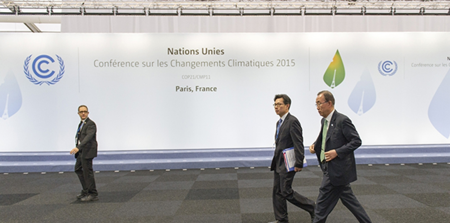 Secretary-General Ban Ki-moon (right) between meetings during the UN Climate Change Conference in Paris (COP 21), on November 30, 2015. (UN Photo/Rick Bajornas)