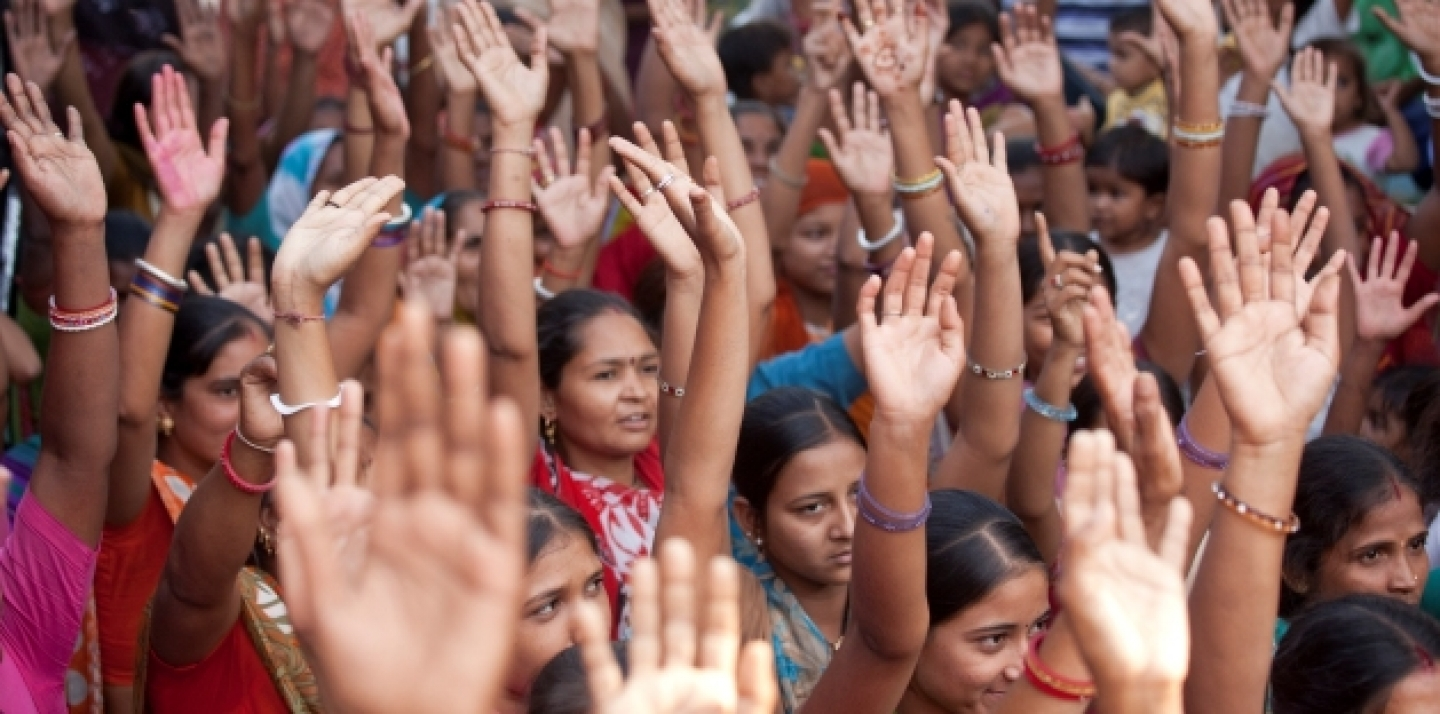 Community members in Gujarat, India, participate in discussions after watching video documentaries screened by the Self Employed Women's Association of India, 2010. (Gates Foundation)