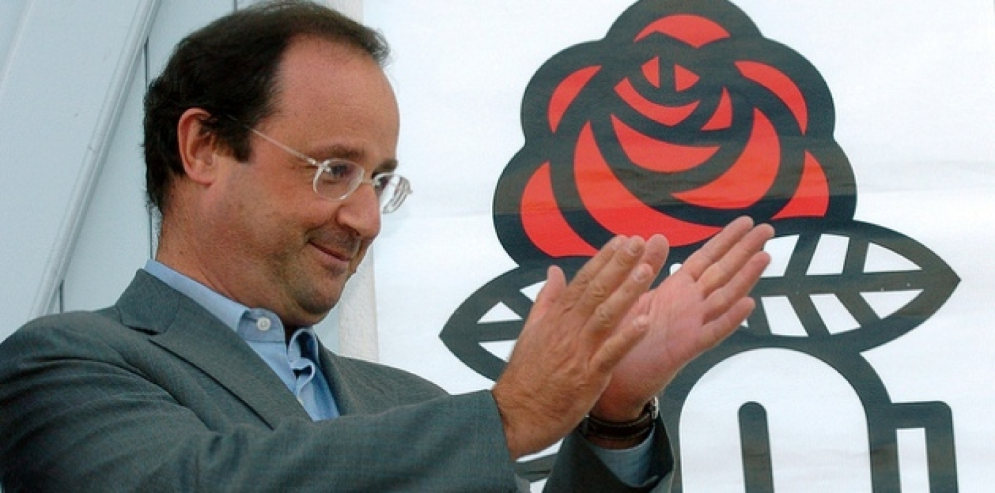 Francois Hollande, head of the French Socialist Party, applauds from the balcony of the Charentes Socialist Federation headquarters (AP Photo/Bob Edme)
