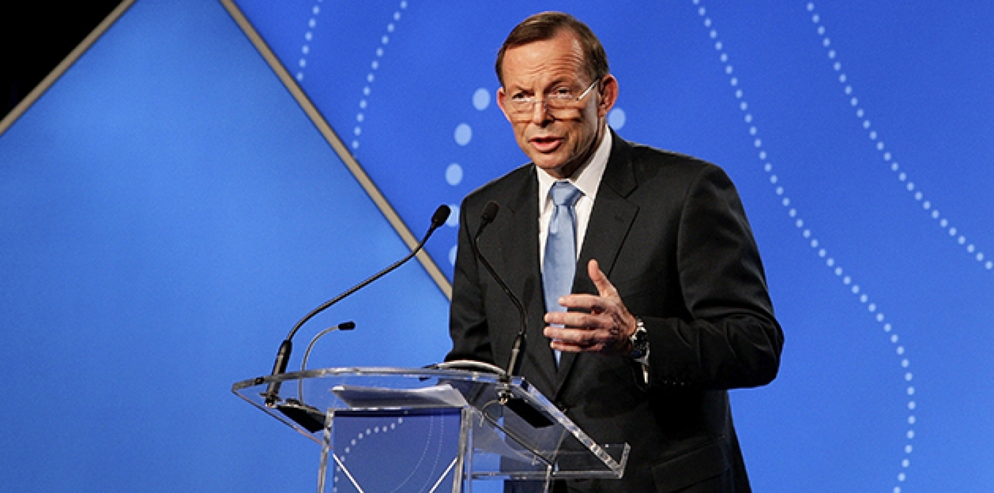 Australian Prime Minister Tony Abbott delivers his keynote speech during the B20 Summit in Sydney. (AP Photo/Lisa Maree Williams/Pool)