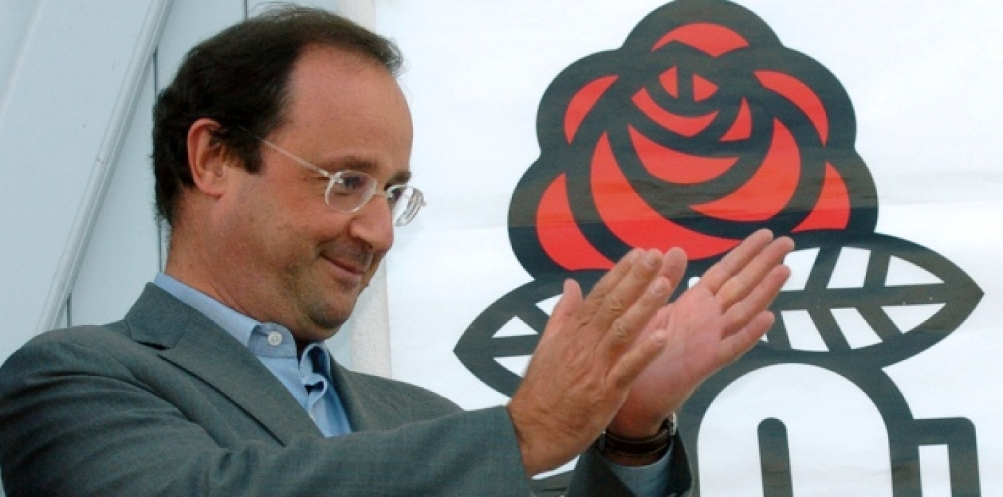 Francois Hollande, head of the French Socialist Party, applauds from the balcony of the Charentes Socialist Federation headquarters in La Rochelle, southwestern France, Thursday, Aug. 24, 2006 (AP Photo/Bob Edme).
