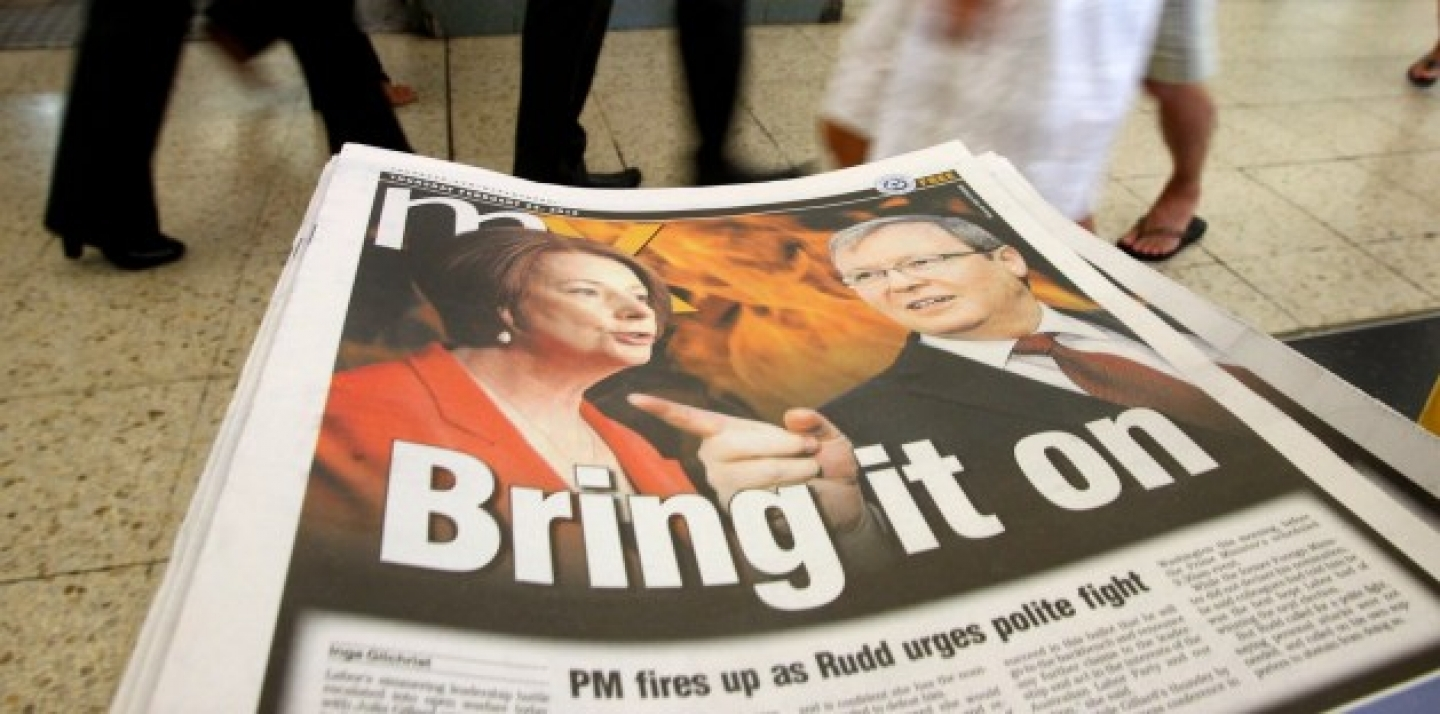 Photos of Australian Prime Minister Julia Gillard, left, and former Foreign Minister Kevin Rudd, are displayed on a newspaper at a train station Thursday, Feb. 23, 2012, in Sydney (AP Photo/Rick Rycroft).