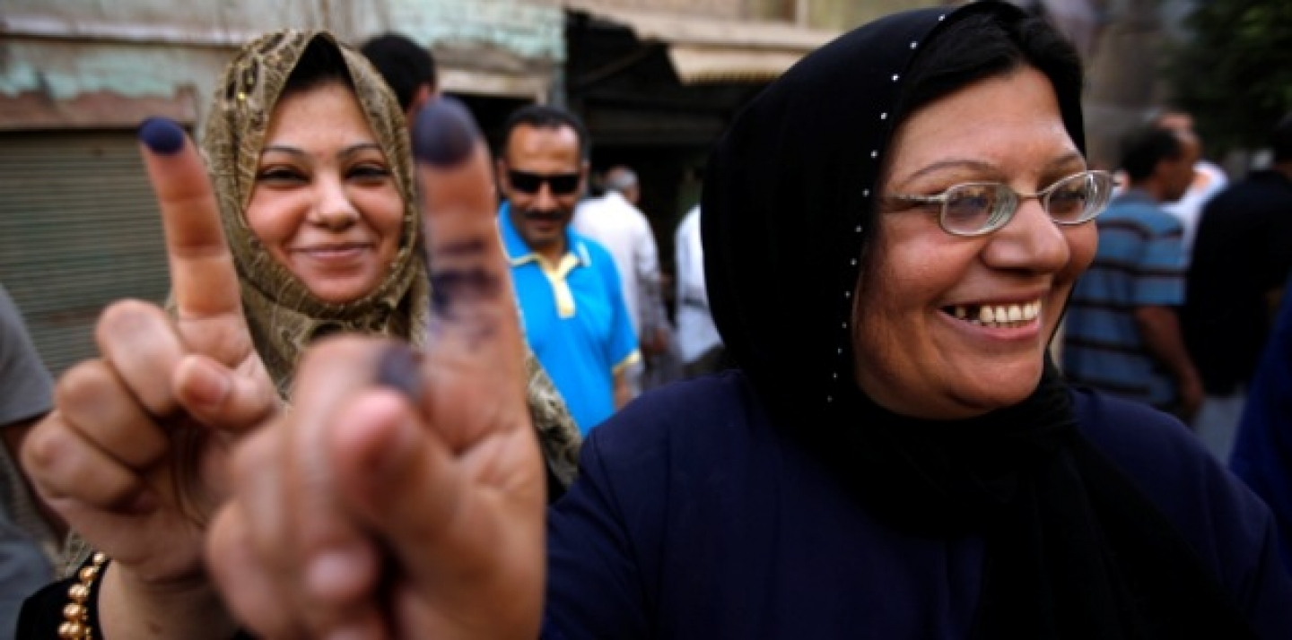 Two women show their inked fingers after casting their votes on the first day of the Presidential election at a polling center in Old Cairo, Egypt, Wednesday, May 23, 2012. (AP Photo/Fredrik Persson)