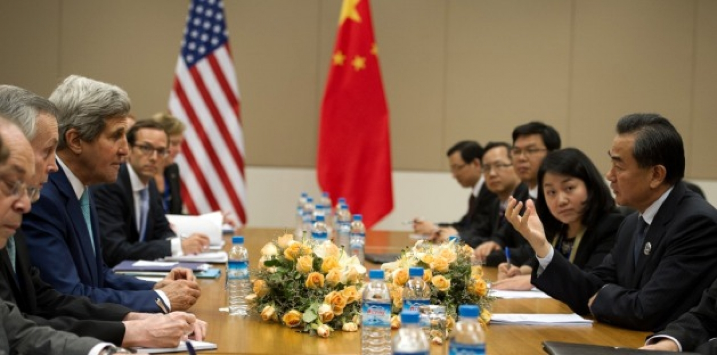 U.S. Secretary of State John Kerry talks with Chinese Foreign Minister Wang Yi during their bilateral meeting held on the sidelines of the 47th Association of Southeast Asian Nations foreign ministers' meeting in Myanmar, on August 9 2014. (AP Photo/Nicolas Asfouri, Pool)