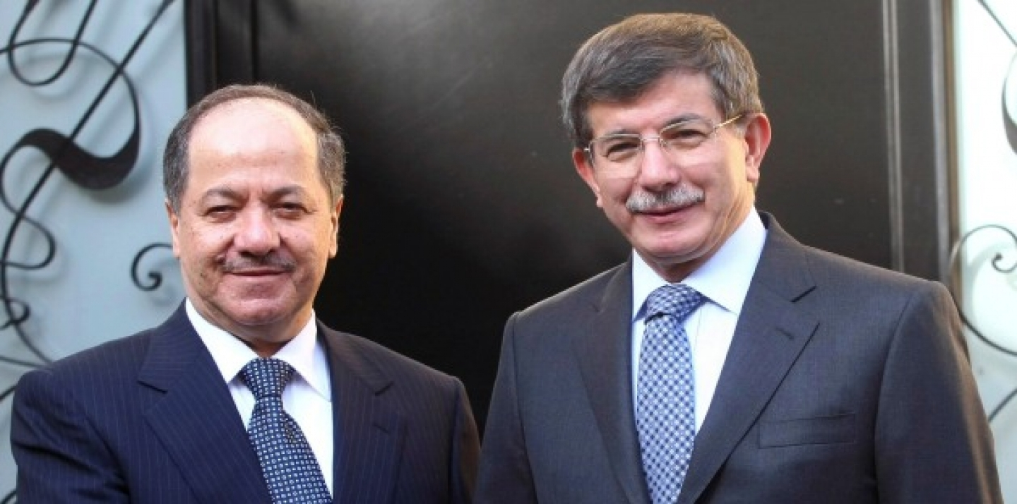 Iraqi Kurdish leader Massoud Barzani, left, and Turkish Foreign Minister Ahmet Davutoglu shake hands before a meeting in Ankara, Turkey, Oct. 1, 2012. (AP Photo)