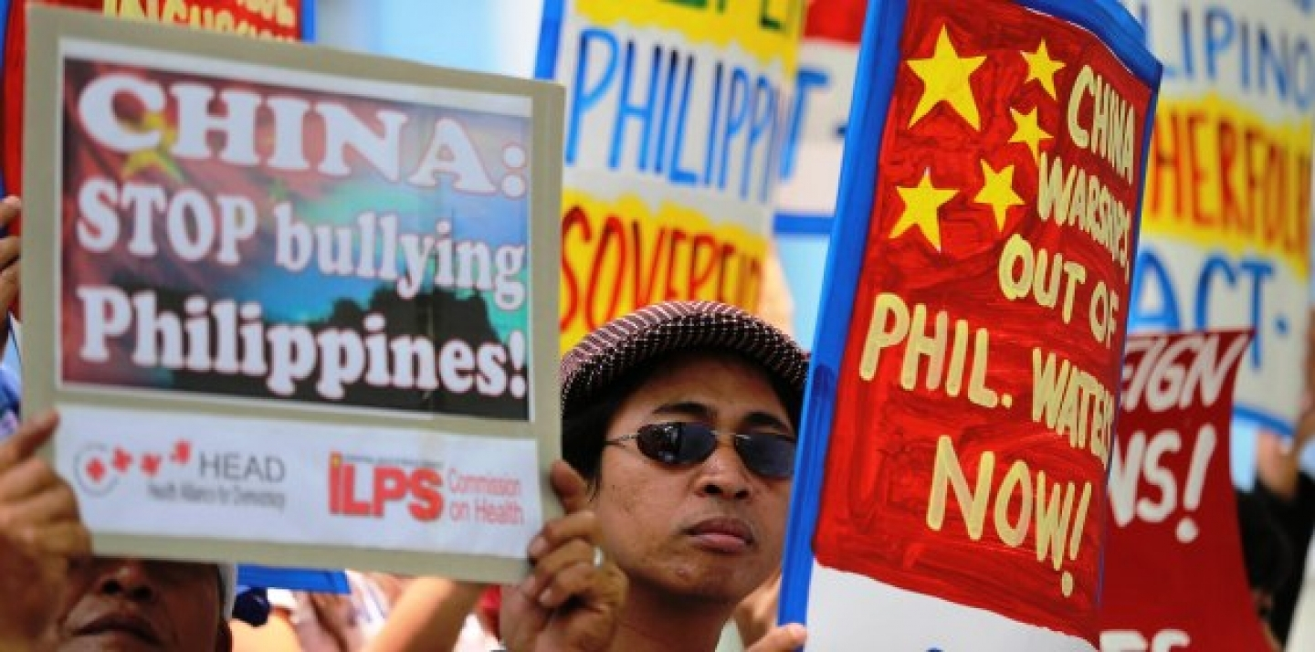 Filipino protesters hold placards with slogans outside the Chinese consulate at the financial district of Makati, south of Manila, Philippines on April 22, 2014. The group is demanding an end to China's alleged incursions in the South China Sea and to press the Chinese government to respect the arbitral process under the United Nations Convention on the Law of the Sea. (AP Photo/Aaron Favila)