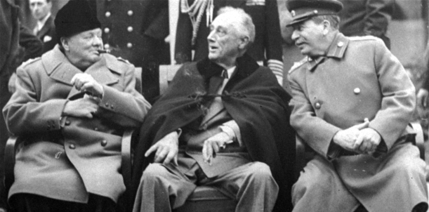 In this Feb.1945 file photo, Prime Minister Winston Churchill, left, meets with President Franklin D. Roosevelt, center, and Russian Marshal Josef Stalin, at the Livadia Palace gardens in Yalta. (AP Photo, File)