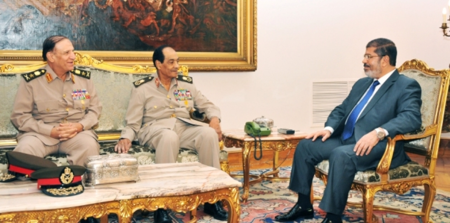 Sami Enan, left, Hussein Tantawi, center, and Egyptian President Mohamed Morsi meet at the Presidential Palace in Cairo, Egypt, Tuesday, Aug. 14, 2012. (AP Photo/Middle East News Agency, HO)