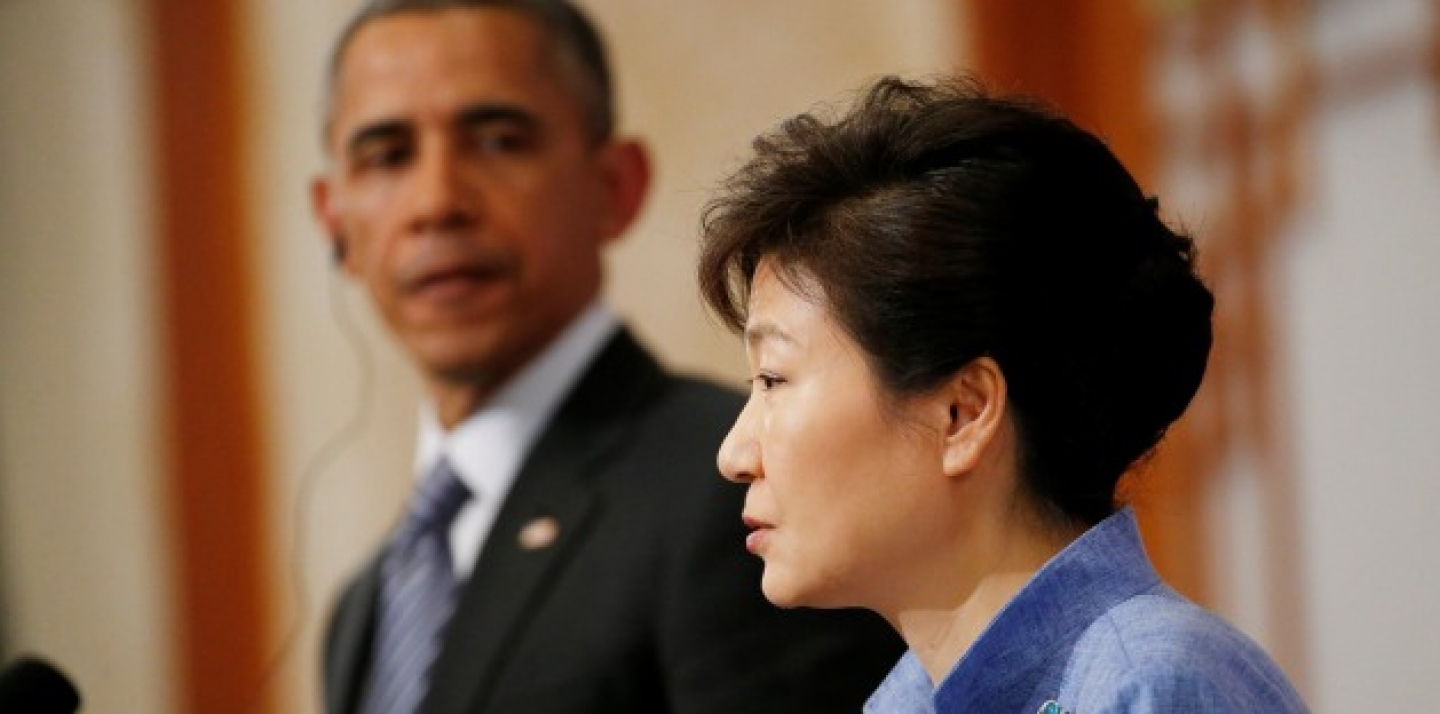 U.S. President Barack Obama looks towards South Korean President Park Geun-hye as she answers a question during a joint news conference at the Blue House in Seoul, South Korea, Friday, April 25, 2014. (AP Photo/Charles Dharapak)