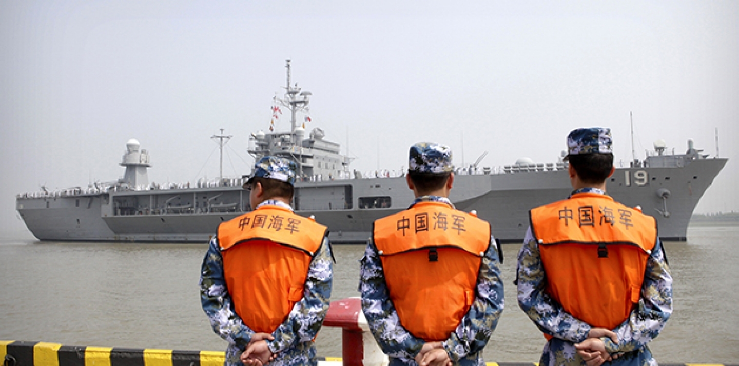 In this May 6, 2016, file photo, soldiers from the Chinese People's Liberation Army (PLA) Navy watch as the USS Blue Ridge arrives at a port in Shanghai. (AP Photo, File)